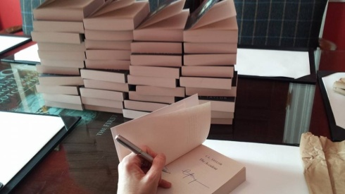Signing 100 copies of The Accident to go in the goody bags for the ladies who attended the luncheon.